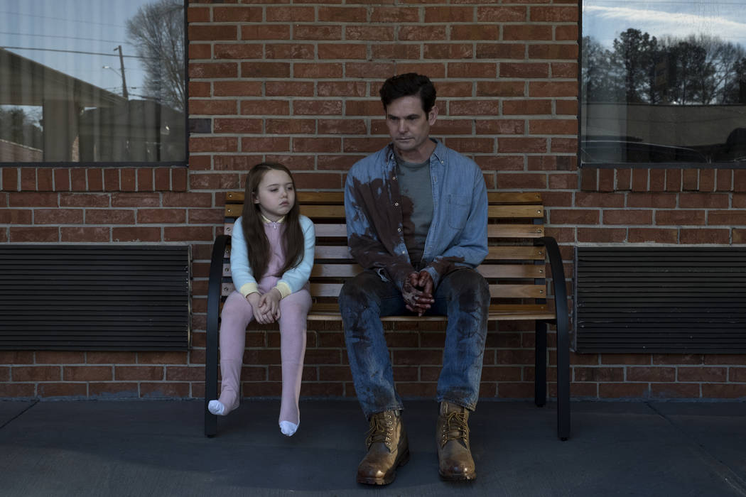 "Violet Mcgraw and Henry Thomas in a scene from ""The Haunting of Hill House."" (Steve Dietl/Netflix)"