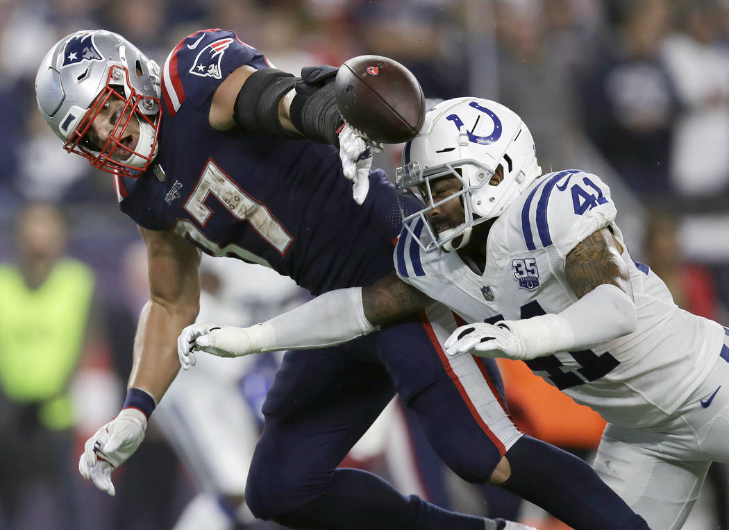UPDATES TO INTERCEPTION, INSTEAD OF FUMBLE - Indianapolis Colts defensive back Matthias Farley (41) and New England Patriots tight end Rob Gronkowski (87) compete for a pass during the second half ...