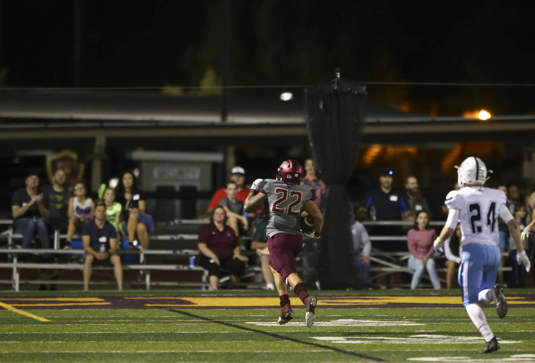 Faith Lutheran's Hunter Kaupiko (22) heads for the end zone to score against Centennial during the first half of a football game at Faith Lutheran High School in Las Vegas on Friday, Sept. 28, 201 ...