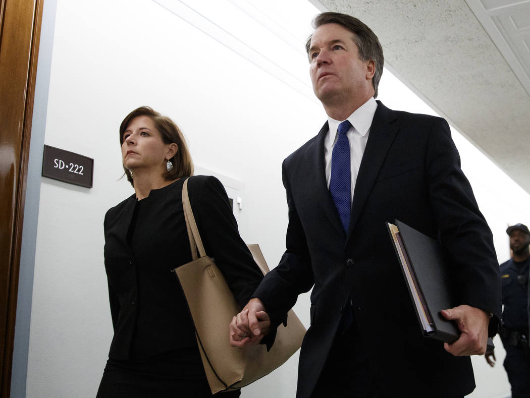 Brett Kavanaugh, President Donald Trump's Supreme Court nominee, and his wife Ashley Estes Kavanaugh, hold hands as they arrive for a Senate Judiciary Committee hearing on Capitol Hill in Washingt ...