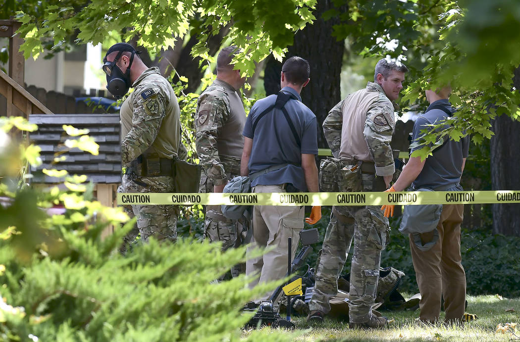 Law enforcement officers search a house on Wednesday, Oct. 3, 2018, in Logan, Utah. A man suspected of mailing ricin to the Pentagon and President Donald Trump was taken into custody at the scene. ...