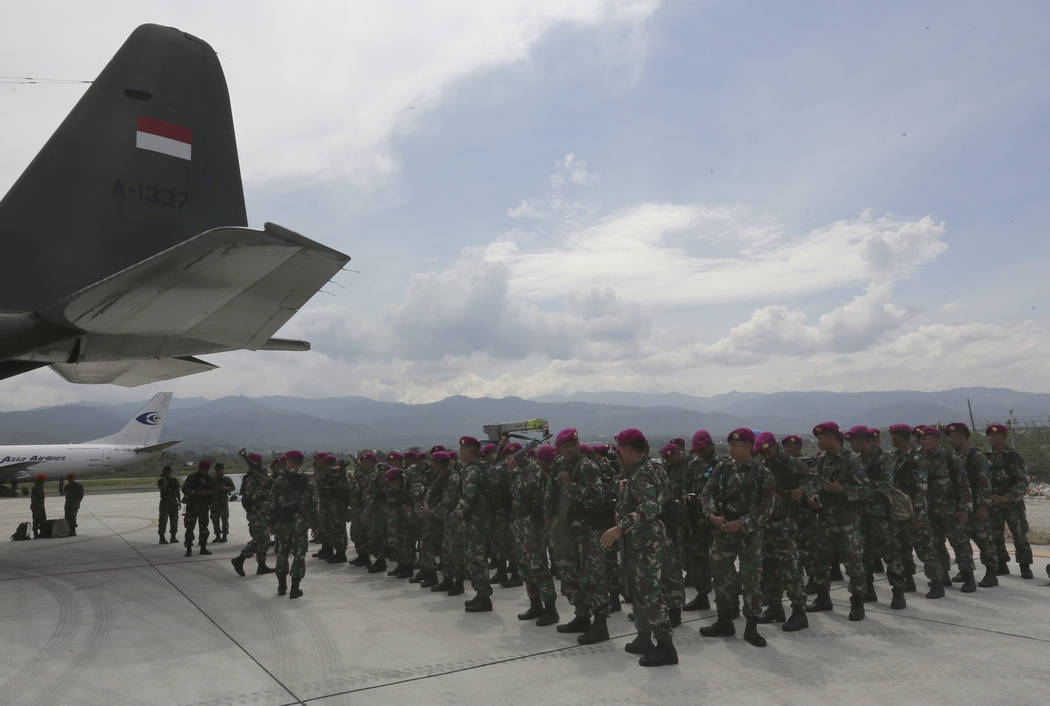 Indonesian Marines arrive to help deliver relief aid relief at the Mutiara Sis Al-Jufri airport in Palu, Central Sulawesi Indonesia, Thursday, Oct. 4, 2018. Life is on hold for thousands living in ...