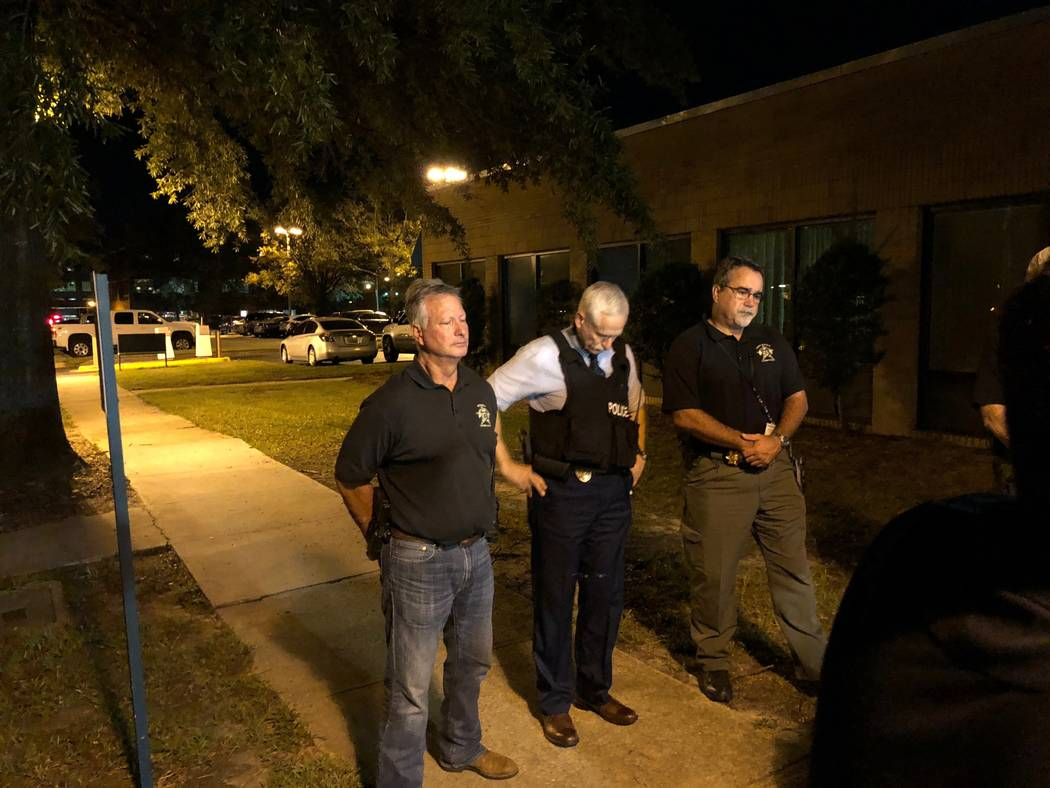 Florence County Sheriff Kenney Boone, from left, Florence Police Chief Allen Heidler and Florence County Chief Deputy Glenn Kirby speak to the media following a shooting where several law enforcem ...