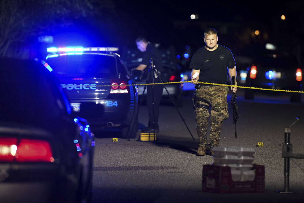 A sheriff's deputy exits the crime scene on Ashton Drive in the Vintage Place neighborhood where several members of law enforcement were shot, one fatally, Wednesday, Oct. 3, 2018, in Florence, S. ...