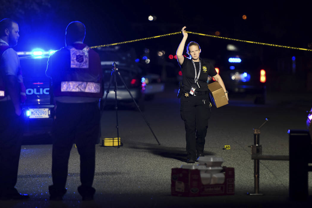 A member of the sheriff's department exits the crime scene on Ashton Drive in the Vintage Place neighborhood where several members of law enforcement were shot, one fatally, Wednesday, Oct. 3, 201 ...