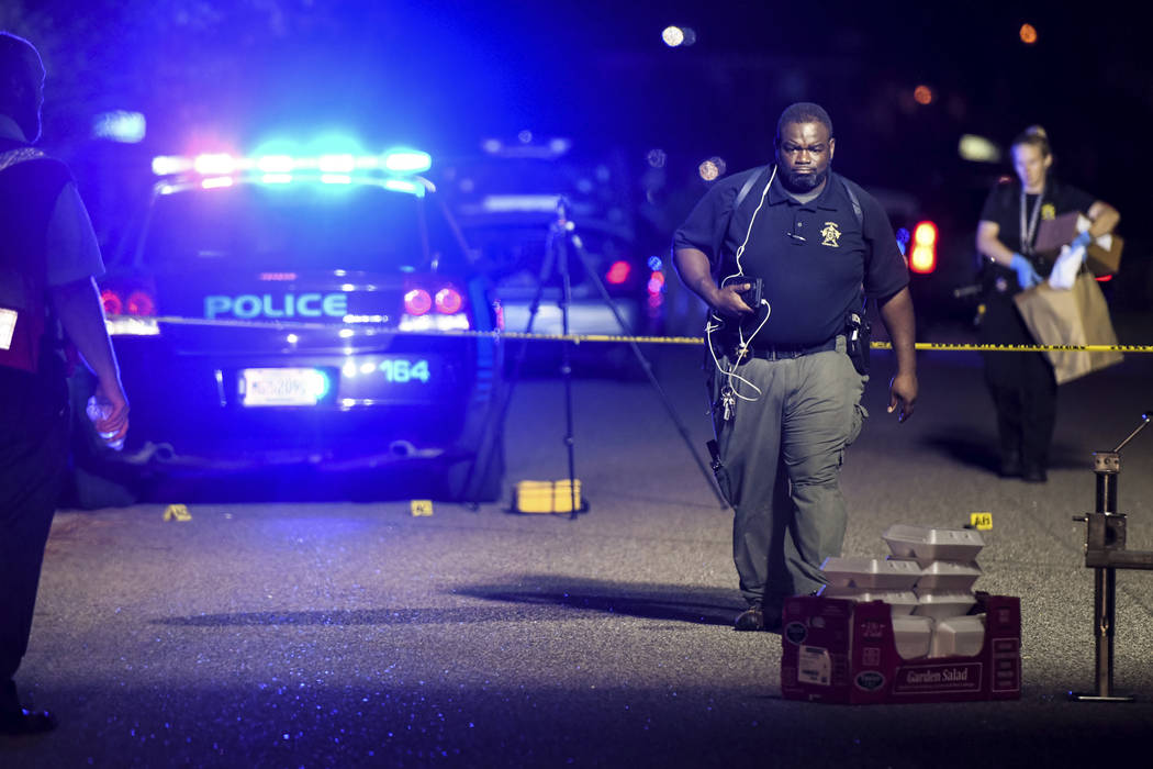 A forensics team member exits the crime scene on Ashton Drive in the Vintage Place neighborhood where several members of law enforcement were shot, one fatally, Wednesday, Oct. 3, 2018, in Florenc ...