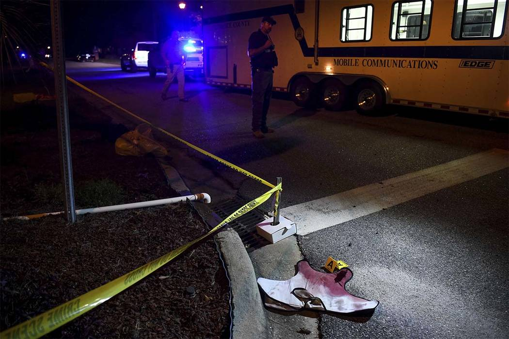 Blood-soaked evidence lies in the Vintage Place neighborhood where several members of law enforcement were shot, one fatally, Wednesday, Oct. 3, 2018, in Florence, S.C. (Sean Rayford/AP)