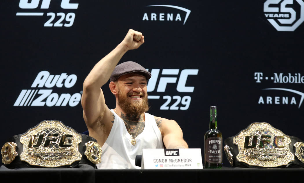Former UFC lightweight and featherweight champion Conor McGregor gestures to fans at the UFC 229 press conference at the Park Theater in the Park MGM in Las Vegas, Thursday, Oct. 4, 2018. Heidi Fa ...