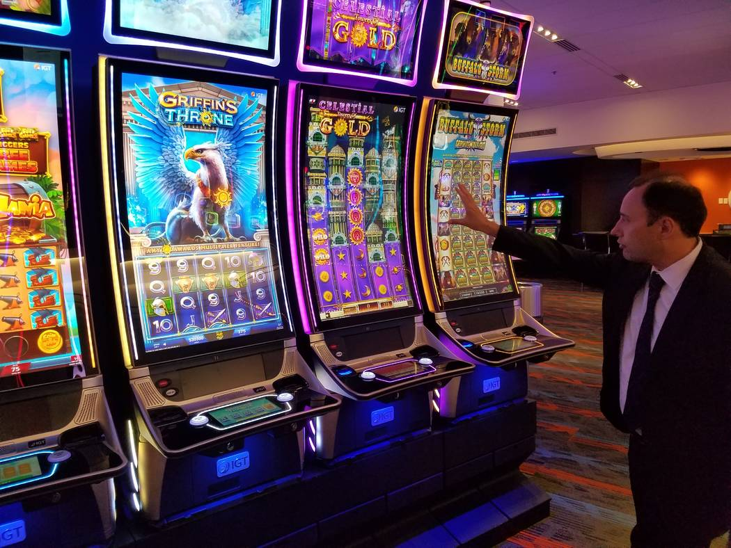 "Nick Khin, IGT's chief commercial officer for gaming, checks out IGT's large format ""Celestial Towers of Gold"" slot machine at the company's Las Vegas showroom on Friday, Sept. 28, 2018. Massive ..."