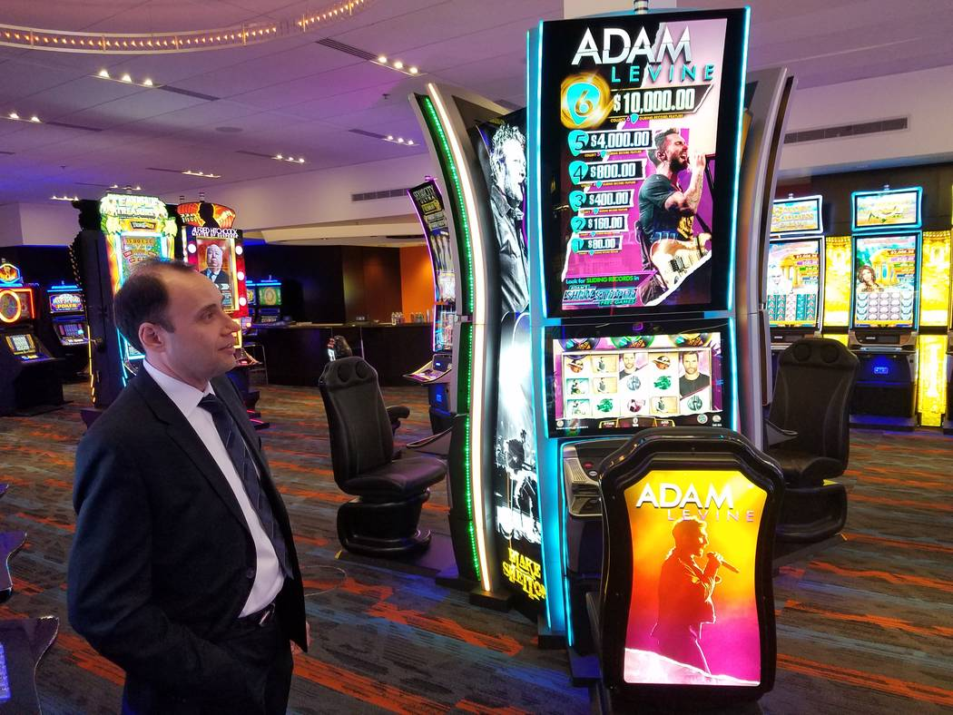 Nick Khin, IGT's chief commercial officer for gaming, checks out the Adam Levine-themed slot machine at IGT's Las Vegas showroom on Friday, Sept. 28, 2018. The machine is one of IGT's offering t ...