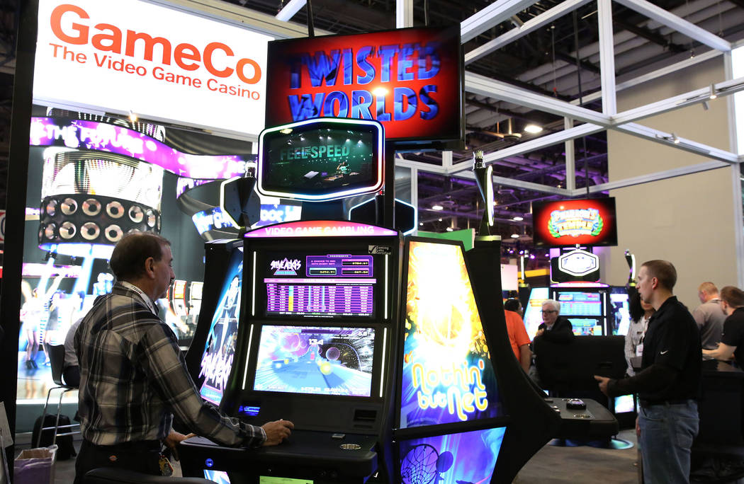 Wayne Weiswasser, left, plays video game gambling during Global Gaming Expo at the Sands Expo and Convention Center on Thursday Oct. 5, 2017, in Las Vegas. Bizuayehu Tesfaye Las Vegas Review-Journ ...