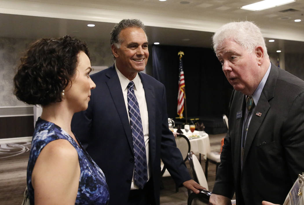 Danny Tarkanian, Republican candidate for the 3rd Congressional District, second left, and his wife Amy, left, chat with John Hambrick, State Assembly District 2, during the Women's Chamber 2018 c ...