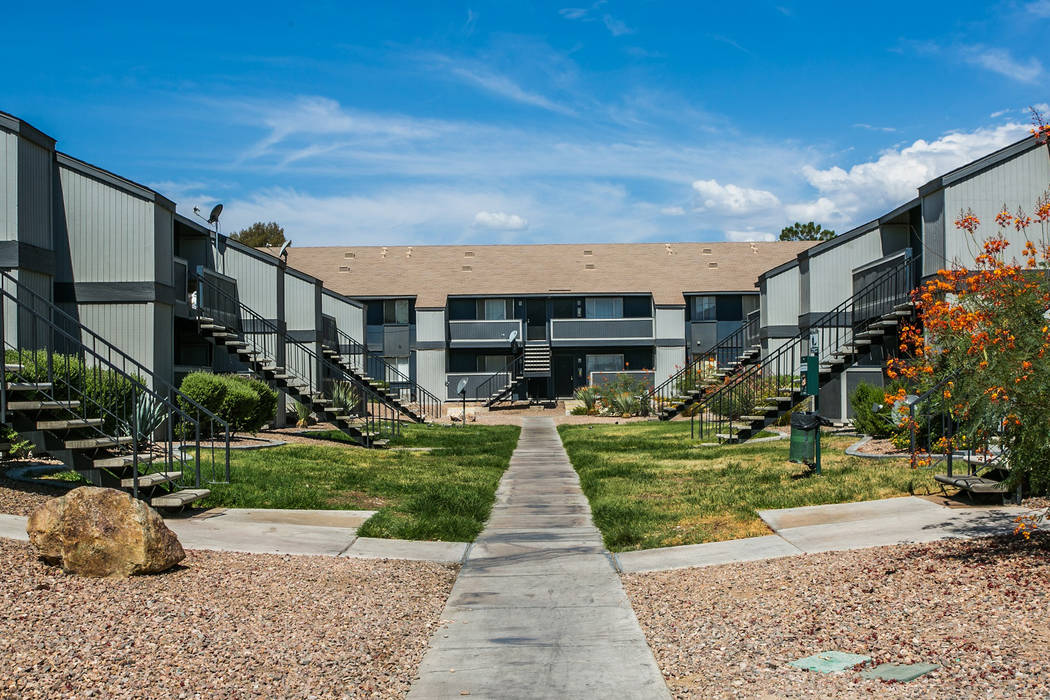 Tower 16 Capital Partners acquired the 540-unit Cornerstone Crossing apartment complex in Las Vegas, seen above, for $49.75 million in a joint venture with Henley USA. (Anton Communications)