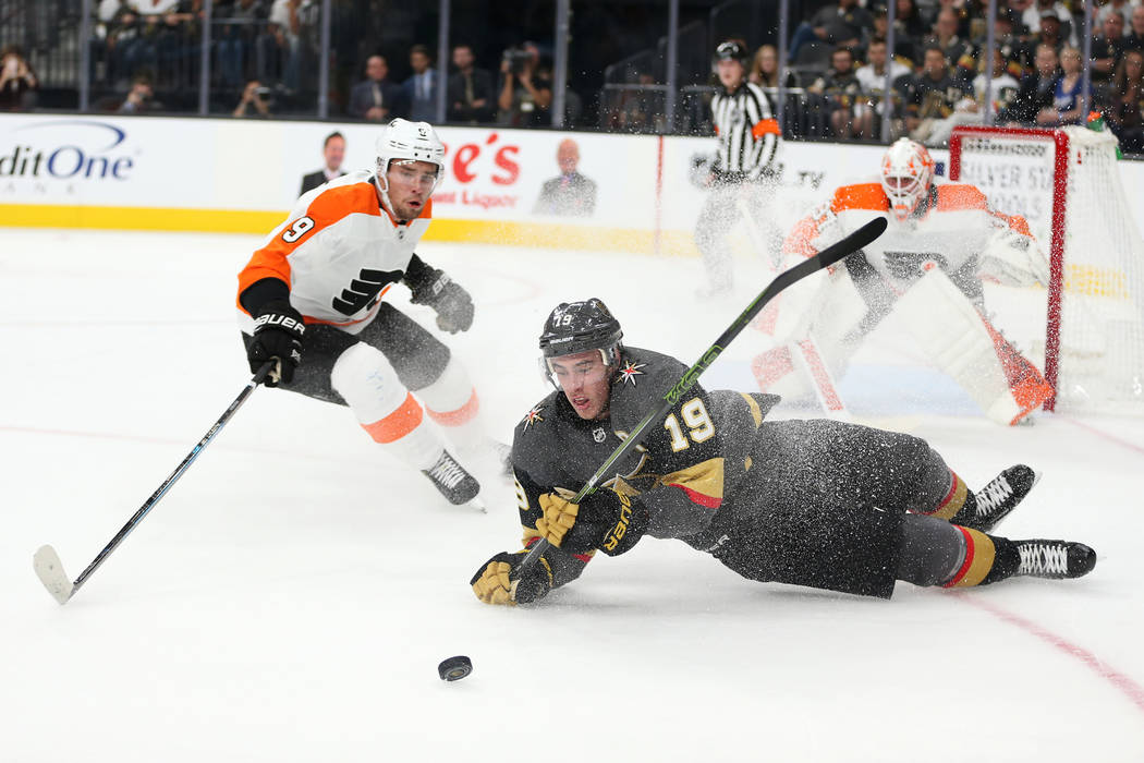 Vegas Golden Knights right wing Reilly Smith (19) takes a fall under pressure from Philadelphia Flyers defenseman Ivan Provorov (9) in the first period of a hockey game at T-Mobile Arena in Las Ve ...