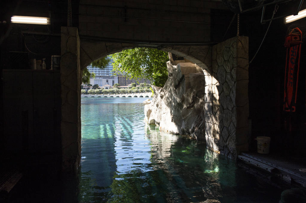 """The maintenance team takes a tunnel from the maintenance area for the Fountains at Bellagio, nicknamed the """"Batcave"""", that leads out to the fountain itself in Las Vegas, Wednesday, Oct. ..."""
