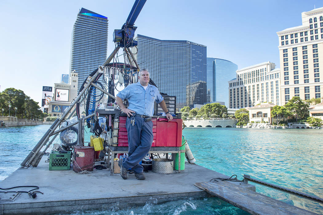 Lead engineer Loni Singer stands atop a barge floating on top of the Fountains of Bellagio in Las Vegas, Wednesday, Oct. 3, 2018. Caroline Brehman/Las Vegas Review-Journal @carolinebrehman