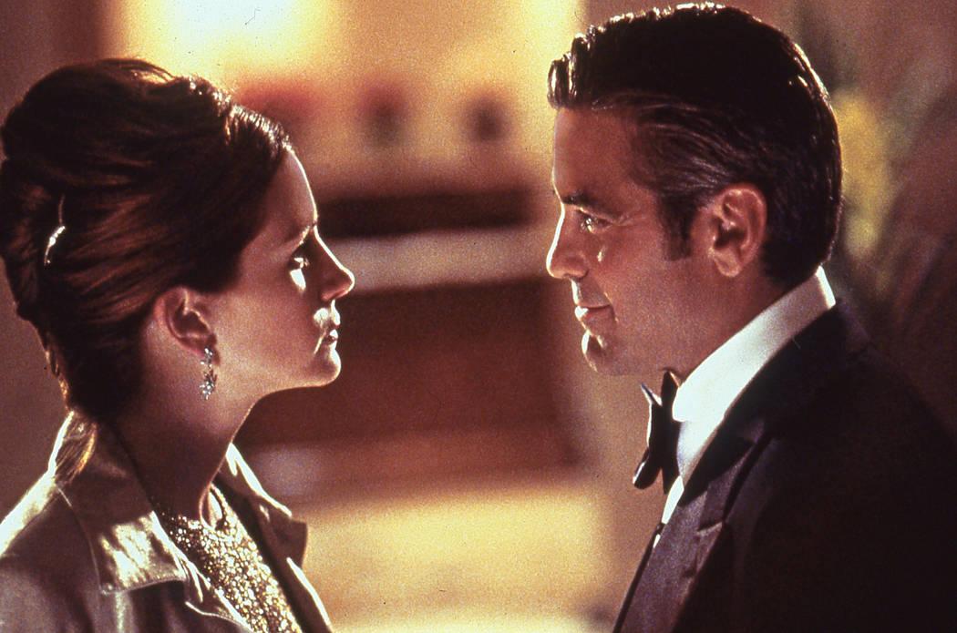 Julia Roberts and George Clooney star in Ocean's 11. 2001 Warner Bros.