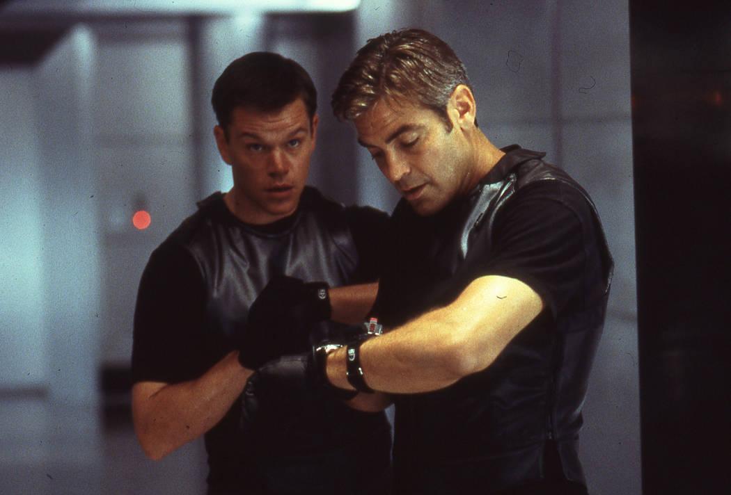 Matt Damon and George Clooney star in Ocean's 11. 2001 Warner Bros.
