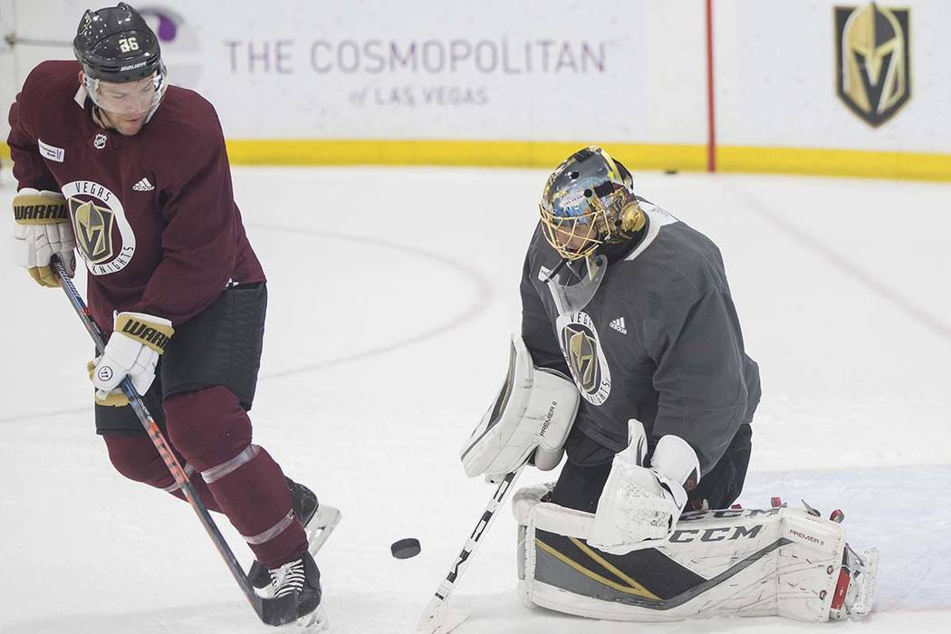 Golden Knights goaltender Marc-Andre Fleury, right, makes a save against center Paul Stastny during practice on Wednesday, Oct. 3, 2018, at City National Arena, in Las Vegas. Benjamin Hager Las Ve ...