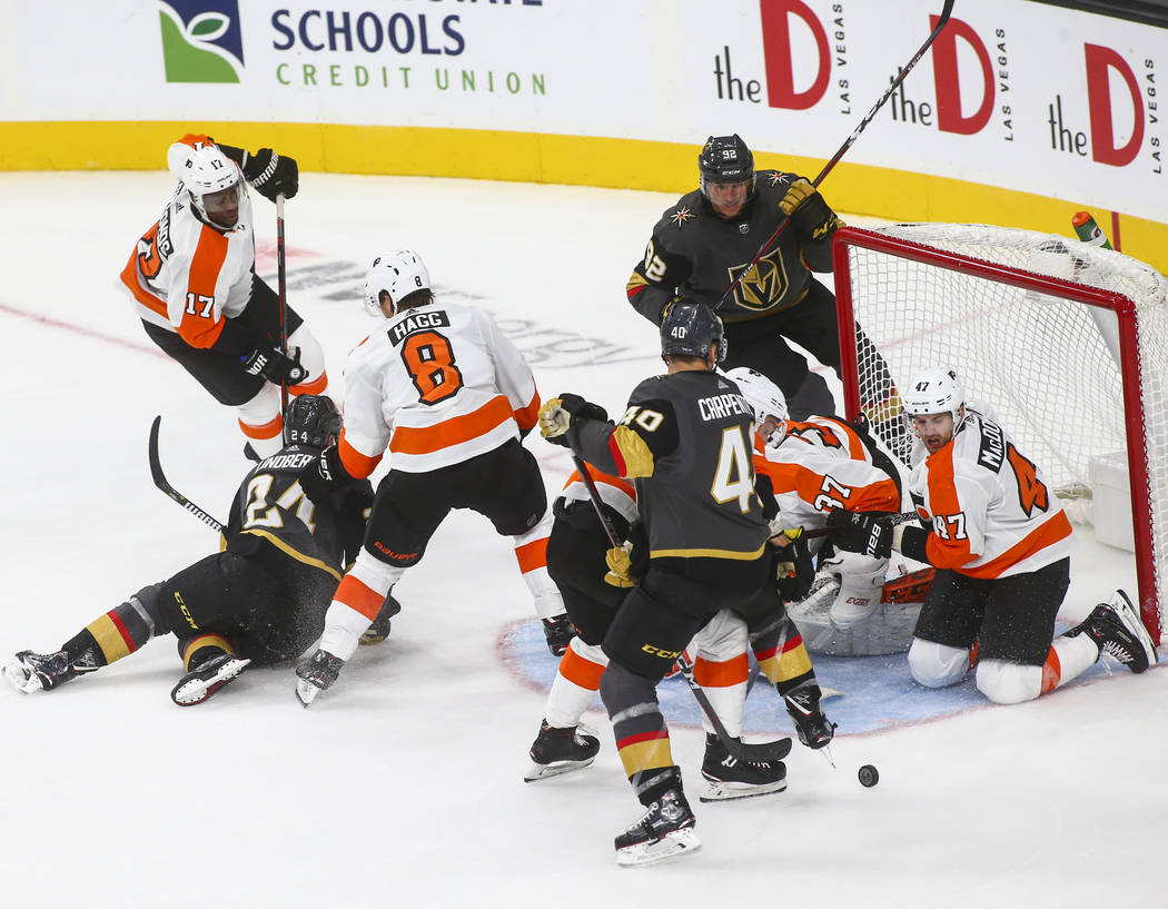 Golden Knights center Ryan Carpenter (40) tries to get the puck past the Philadelphia Flyers during the third period of a season-opening game at T-Mobile Arena in Las Vegas on Thursday, Oct. 4, 20 ...