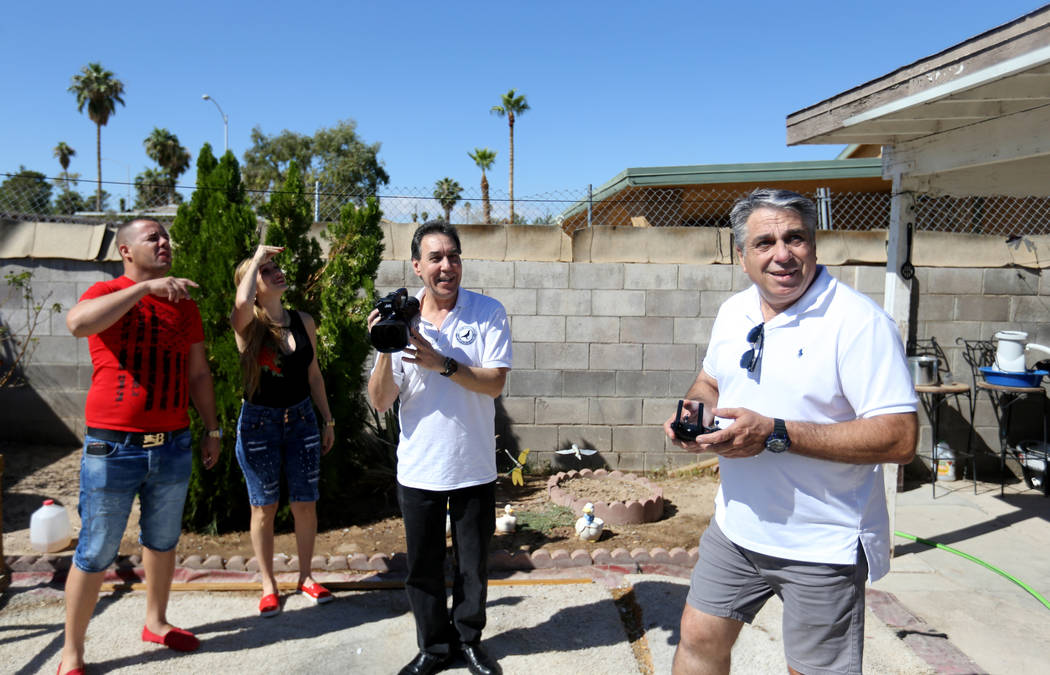 Rasiel Martinez, from left, his wife Olaidys Ramos, Oscar Ruiz and Vincent Valenzuela react to the arrival of a pigeon on the Cher Ami leg of the Racing Pigeon Cross Country Relay from Victorville ...