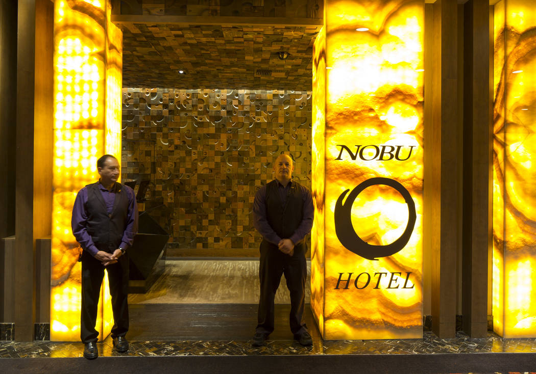 Bellmen stand at the entrance to the Nobu Hotel, a boutique hotel at Caesars Palace in Las Vegas on Thursday, Oct. 4, 2018. Richard Brian Las Vegas Review-Journal @vegasphotograph