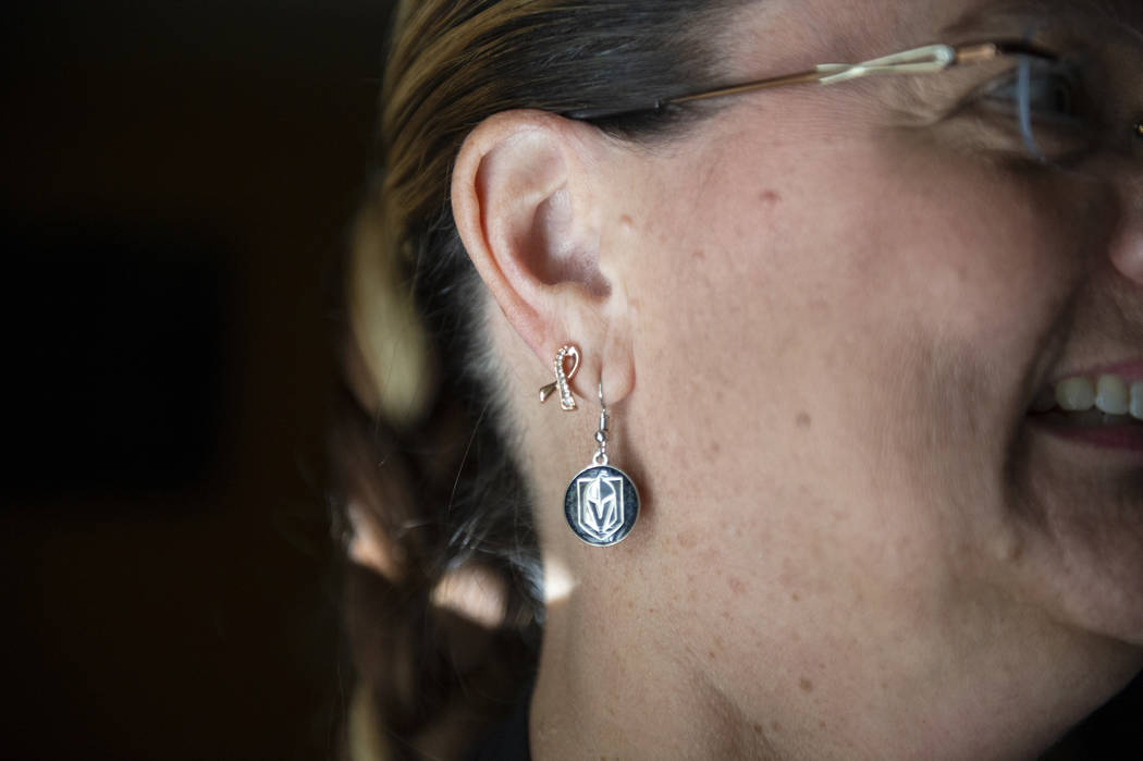In her fight against stage 4 metastatic breast cancer, Kelly Trolia wears breast cancer ribbon earring home in Las Vegas, Wednesday, Oct. 10, 2018. Caroline Brehman/Las Vegas Review-Journal @carol ...