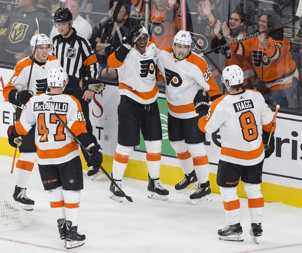 Philadelphia Flyers right wing Wayne Simmonds (17) celebrates with teammates James Van Riemsdyk (25) and Robert Hagg (8) after scoring a goal in the first period during their NHL hockey game with ...