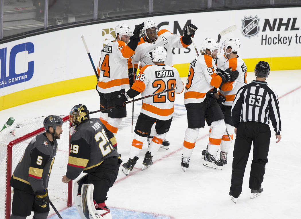 Philadelphia Flyers right wing Wayne Simmonds (17) celebrates with teammates Robert Hagg (8) and Mikhail Vorobyev (24) after scoring a second period goal against Golden Knights goaltender Marc-And ...