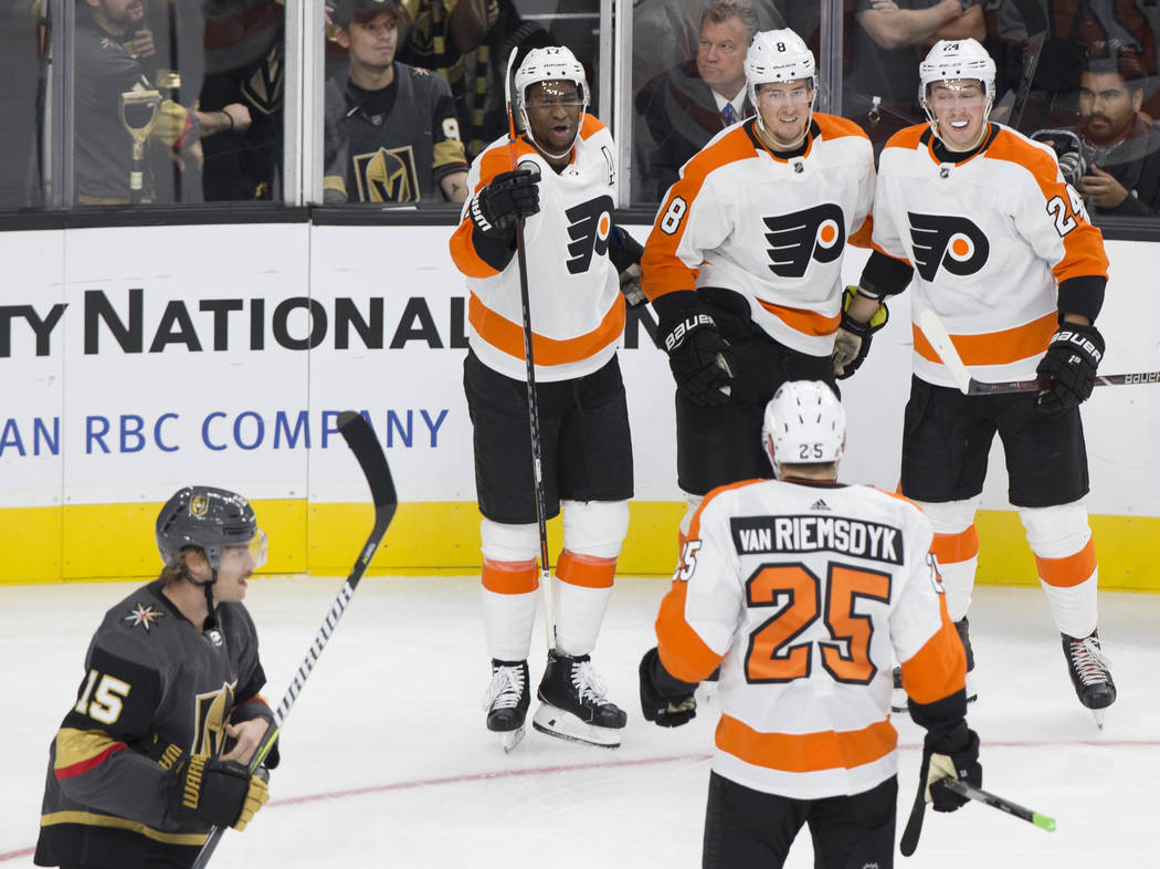 Philadelphia Flyers right wing Wayne Simmonds (17) celebrates with teammates Robert Hagg (8) and Mikhail Vorobyev (24) after scoring a second period goal during their NHL hockey game with the Gold ...