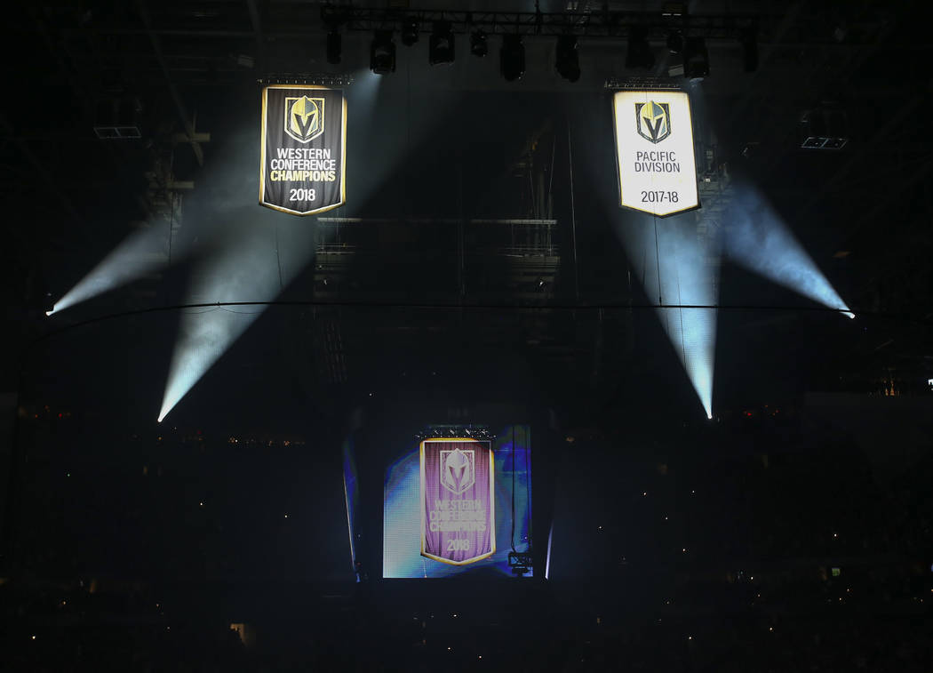 Pacific Division and Western Conference championship banners are raised during a season-opening game between the Golden Knights and Philadelphia Flyers at T-Mobile Arena in Las Vegas on Thursday, ...