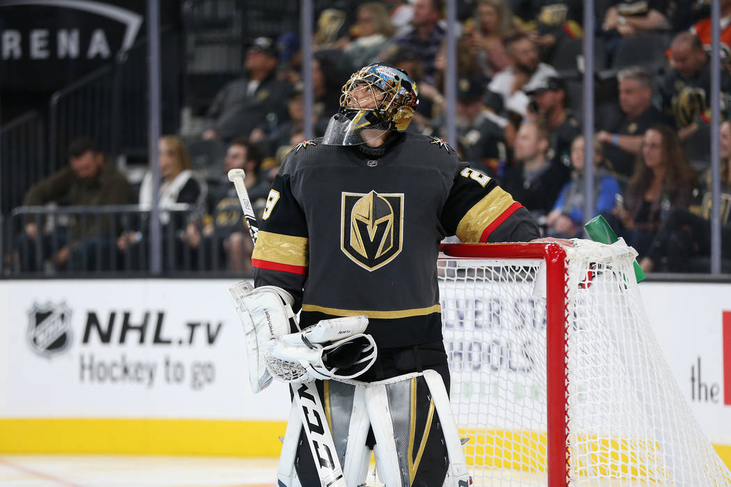 Vegas Golden Knights goaltender Marc-Andre Fleury (29) looks at the scoreboard after allowing a score in the second period of a hockey game at T-Mobile Arena in Las Vegas, Thursday, Oct. 4, 2018. ...