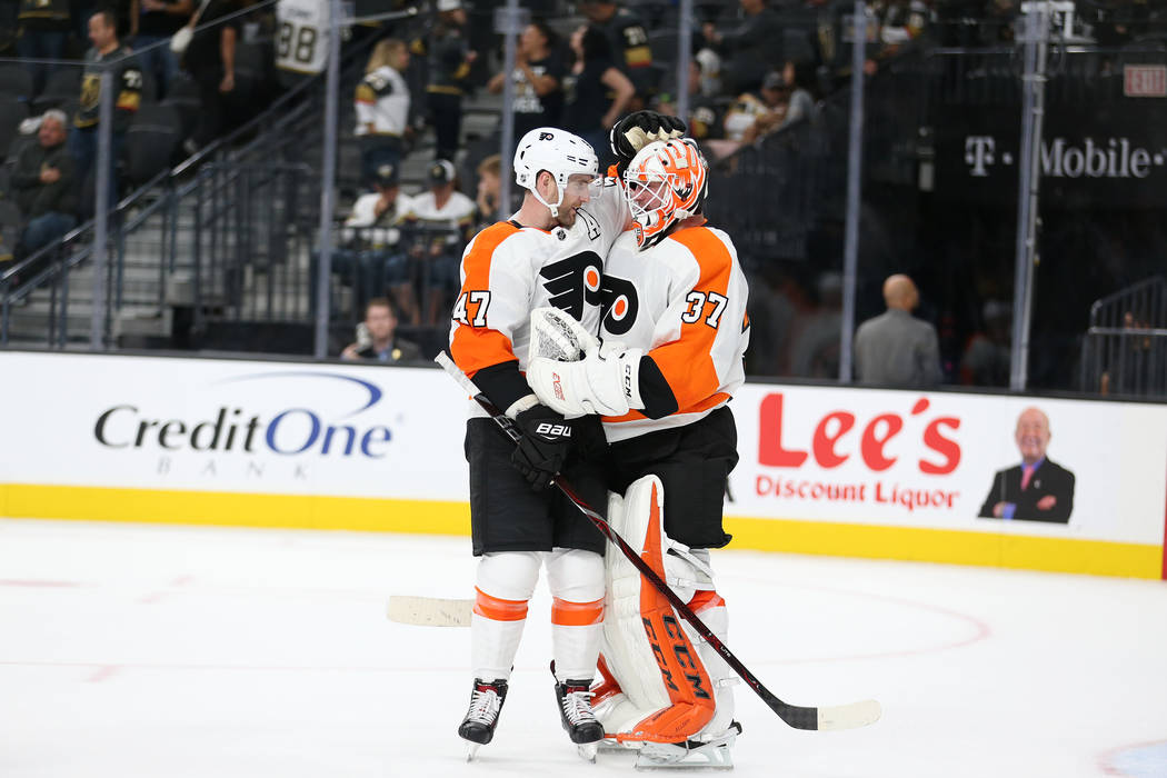 Philadelphia Flyers defenseman Andrew MacDonald (47) and goaltender Brian Elliott (37) celebrate their 5-2 win against the Vegas Golden Knights in the hockey game at T-Mobile Arena in Las Vegas, T ...