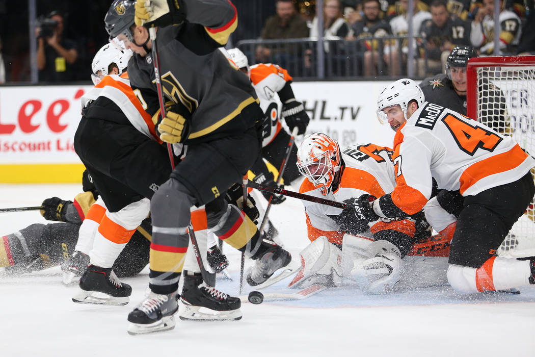 Philadelphia Flyers goaltender Brian Elliott (37) and defenseman Andrew MacDonald (47) defend against Vegas Golden Knights in the third period of a hockey game at T-Mobile Arena in Las Vegas, Thur ...