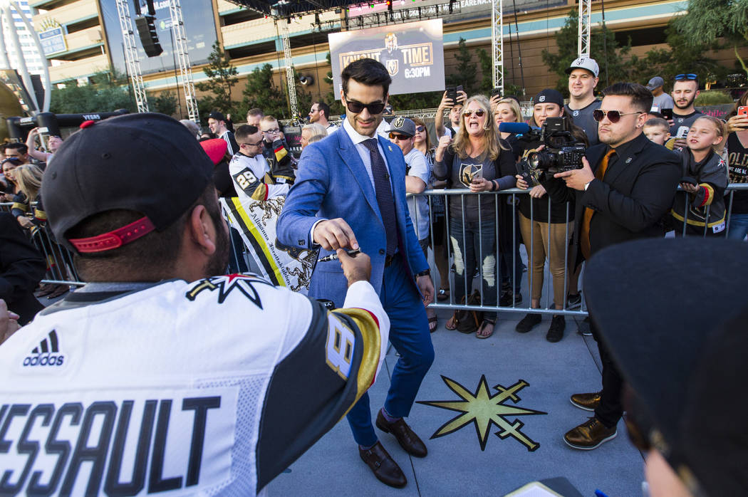Golden Knights left wing Max Pacioretty greets a fan as he arrives before the Golden Knights take on the Philadelphia Flyers in their season-opening game at T-Mobile Arena in Las Vegas on Thursday ...