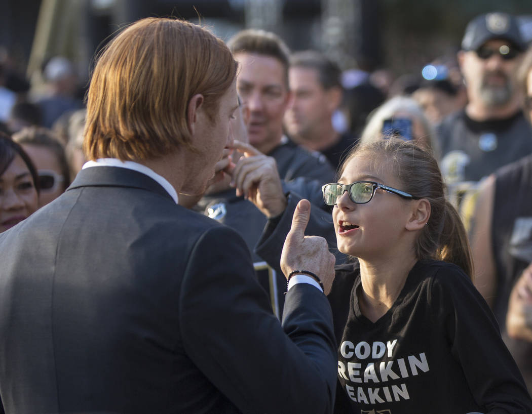 Golden Knights center Cody Eakin, left, gives the thumbs up to fan Rebecca Statskin before the start of Vegas' NHL hockey game with the Philadelphia Flyers on Thursday, Oct. 4, 2018, at T-Mobile A ...