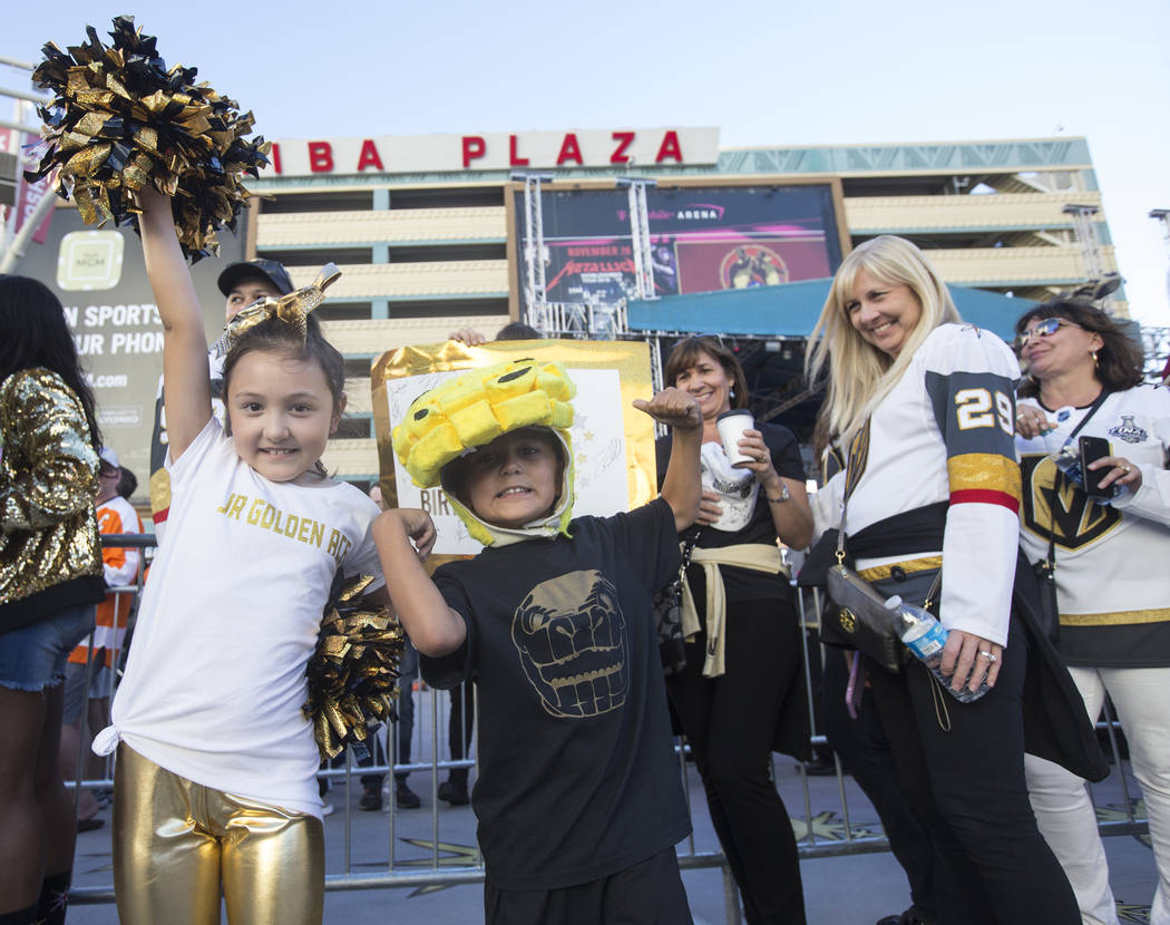 Golden Knights fans Jackson Laricchia, left, and brother Jameson before the start of Vegas' NHL hockey game with the Philadelphia Flyers on Thursday, Oct. 4, 2018, at T-Mobile Arena, in Las Vegas. ...