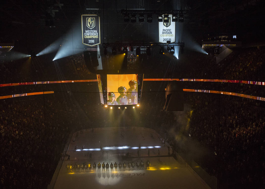 The West Coast Conference Champion and Pacific Division Champion banners are illuminated before the start of the Golden Knights NHL hockey game with the Philadelphia Flyers on Thursday, Oct. 4, 20 ...