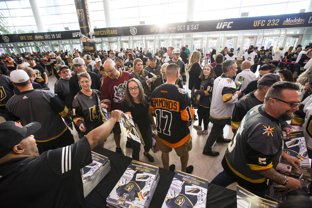Hockey fans get posters before the Golden Knights take on the Philadelphia Flyers in their season-opening game at T-Mobile Arena in Las Vegas on Thursday, Oct. 4, 2018. Chase Stevens Las Vegas Rev ...