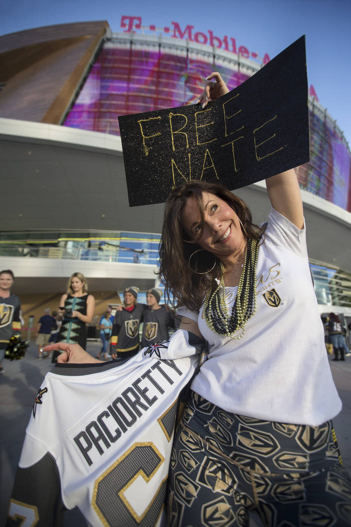 """Golden Knights fan Elizabeth Moreau holds a """"Free Nate"""" sign before the start of Vegas' NHL hockey game with the Philadelphia Flyers on Thursday, Oct. 4, 2018, at T-Mobile Arena, in Las ..."""
