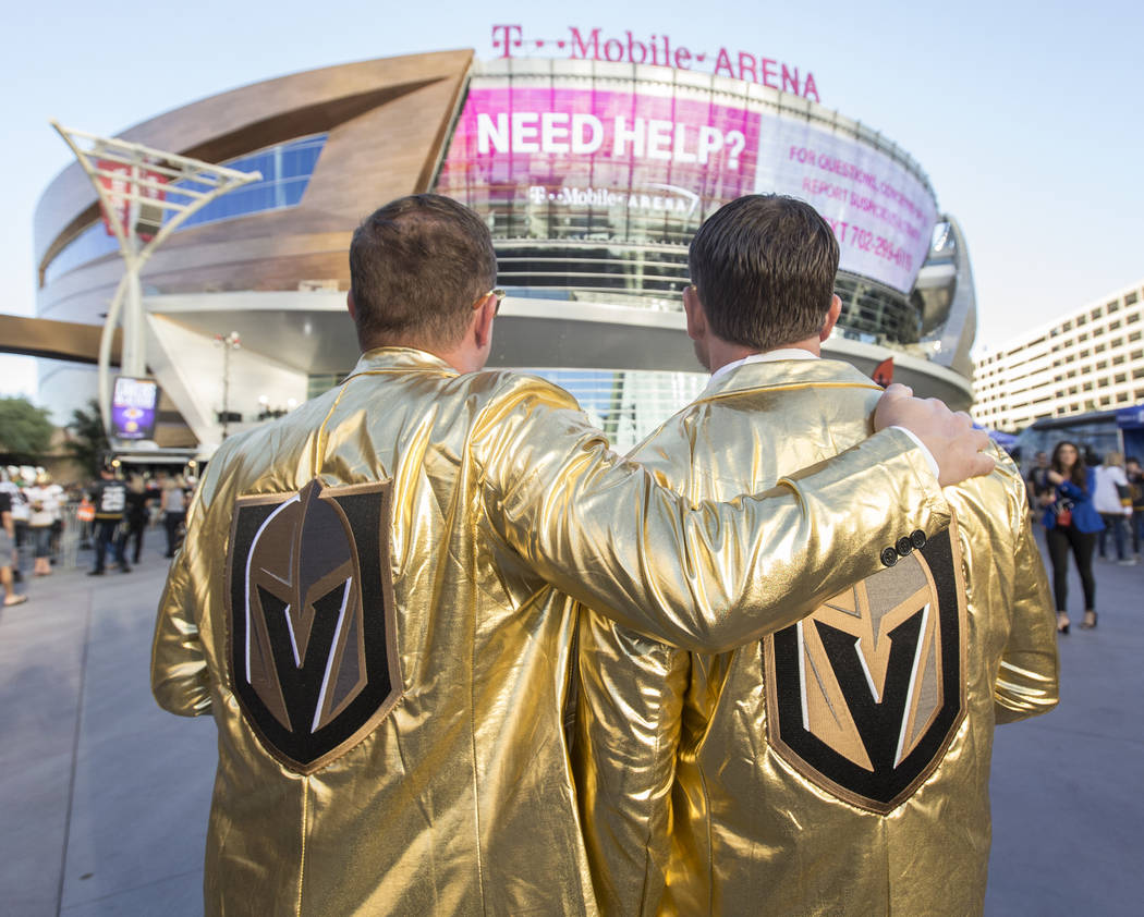Golden Knights fans Eric Foley, left, and Karl Rutledge take a moment to look at T-Mobile Arena before the start of Vegas' NHL hockey game with the Philadelphia Flyers on Thursday, Oct. 4, 2018, i ...