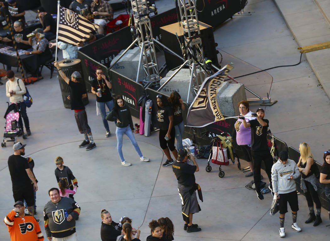 Fans arrive for the season-opening game between the Golden Knights and Philadelphia Flyers at T-Mobile Arena in Las Vegas on Thursday, Oct. 4, 2018. Chase Stevens Las Vegas Review-Journal @cssteve ...