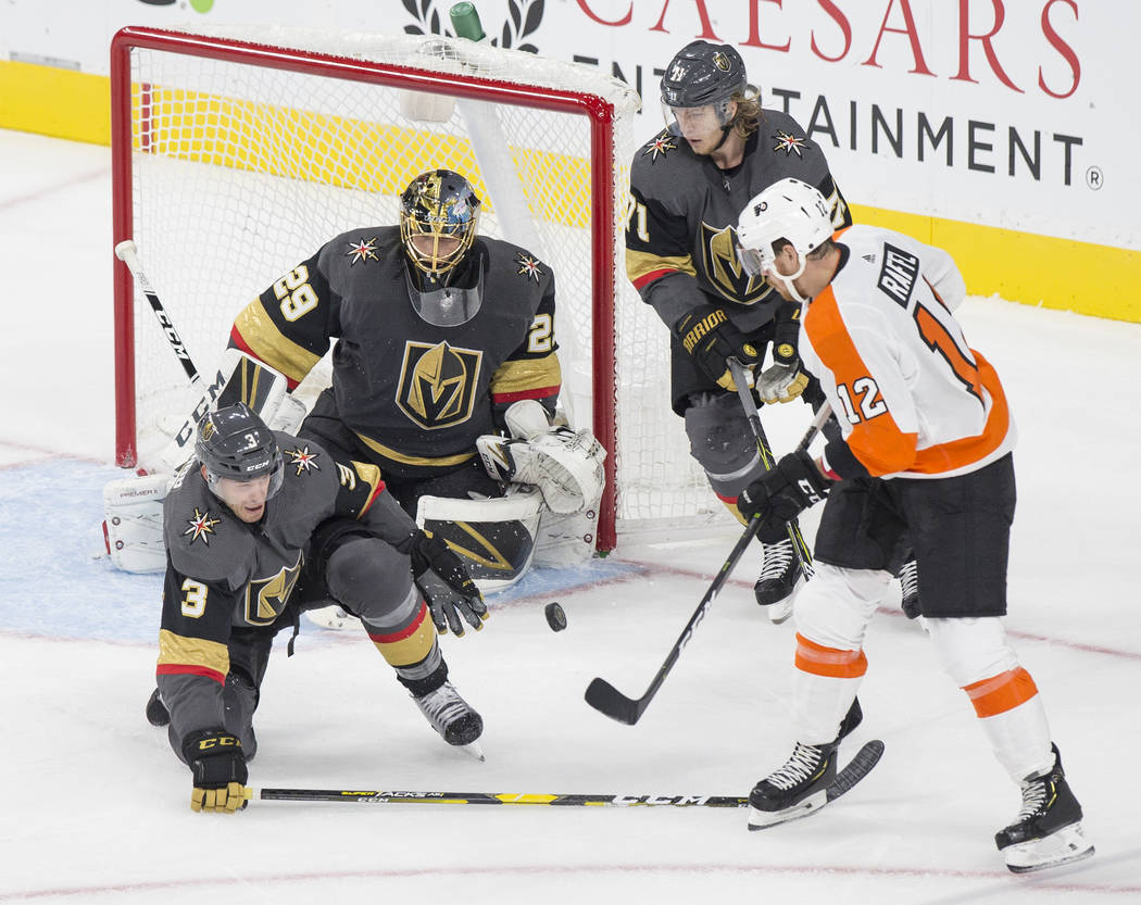Golden Knights goaltender Marc-Andre Fleury (29) makes a first period save against Philadelphia Flyers left wing Michael Raffl (12) during their NHL hockey game on Thursday, Oct. 4, 2018, at T-Mob ...