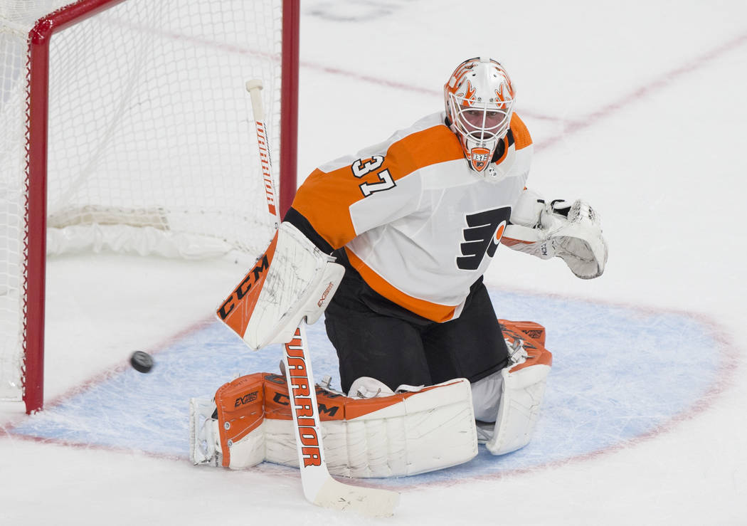 Philadelphia Flyers goaltender Brian Elliott (37) makes a first period save during their NHL hockey game with the Golden Knights on Thursday, Oct. 4, 2018, at T-Mobile Arena, in Las Vegas. Benjami ...