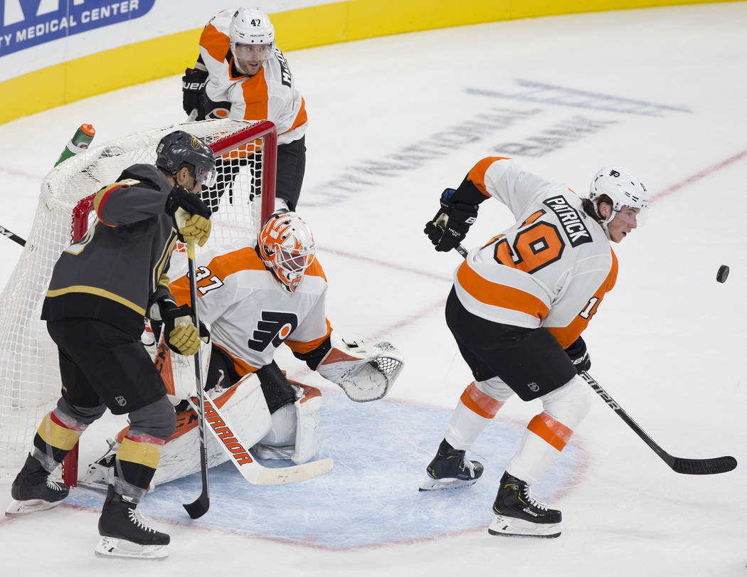 Philadelphia Flyers defenseman Ivan Provorov (9) clears the puck away from goaltender Brian Elliott (37) in the first period during their NHL hockey game on Thursday, Oct. 4, 2018, at T-Mobile Are ...