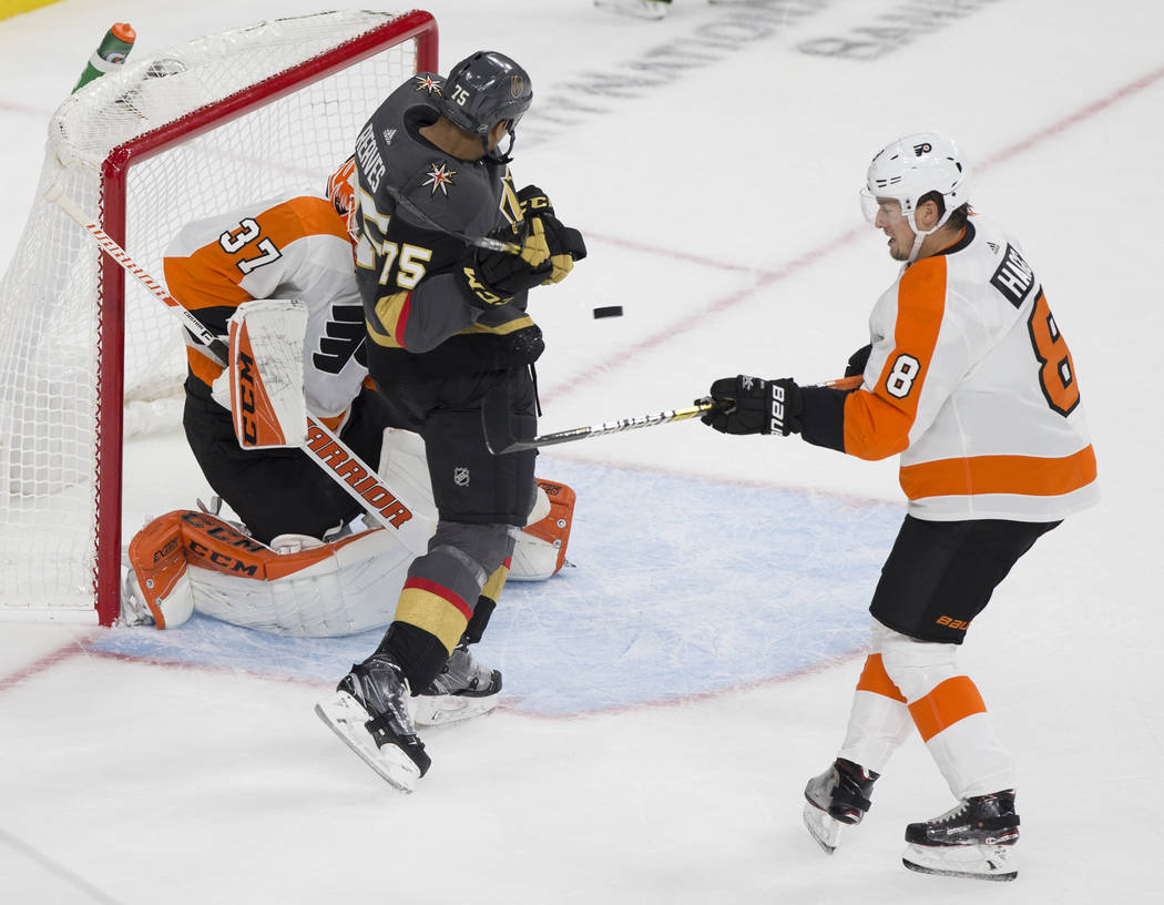 Golden Knights right wing Ryan Reaves (75) collides with Philadelphia Flyers goaltender Brian Elliott (37) with Flyers defenseman Robert Hagg (8) defending in the first period during their NHL hoc ...