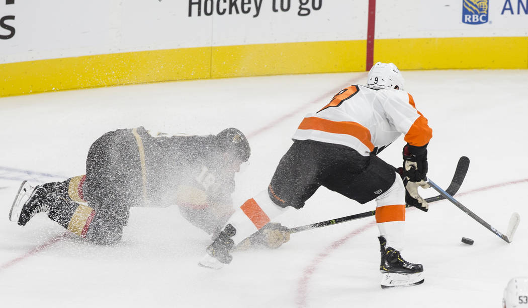 Golden Knights right wing Reilly Smith (19) fights for possession with Philadelphia Flyers defenseman Robert Hagg (8) in the first period during their NHL hockey game on Thursday, Oct. 4, 2018, at ...