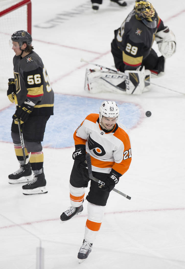 Philadelphia Flyers center Scott Laughton (21) celebrates after scoring a second period goal against Golden Knights goaltender Marc-Andre Fleury (29) during their NHL hockey game with the Golden ...