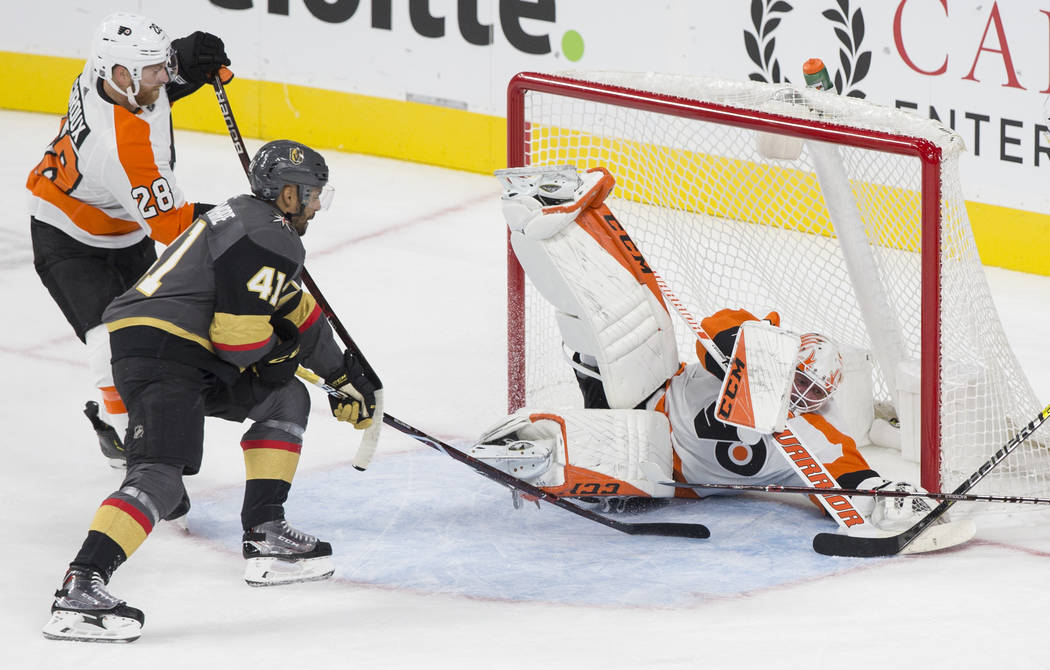 Philadelphia Flyers goaltender Brian Elliott (37) makes a second period save against Golden Knights left wing Pierre-Edouard Bellemare (41) during their NHL hockey game on Thursday, Oct. 4, 2018, ...