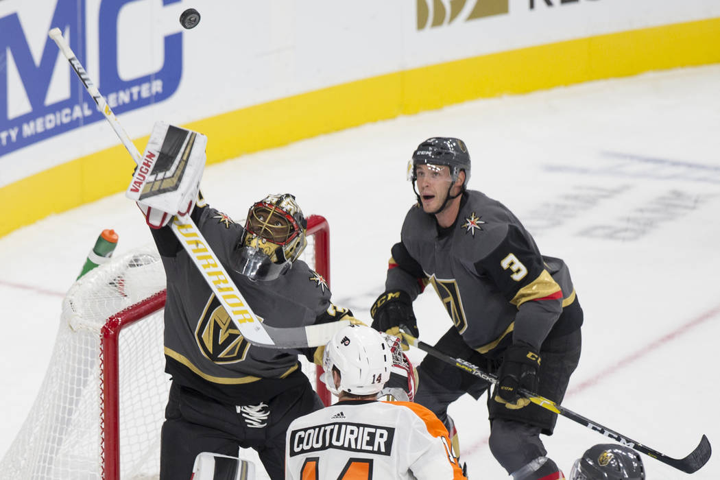Golden Knights goaltender Malcolm Subban (30) makes a second period save against Philadelphia Flyers center Sean Couturier (14) with Golden Knights defenseman Brayden McNabb (3) defending during t ...